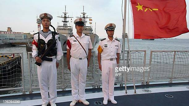 Chinese sailors stand onboard a frigate berthed in Shanghai on September 22 2011 The Chinese navy is playing a key role in Beijing's move to become a...