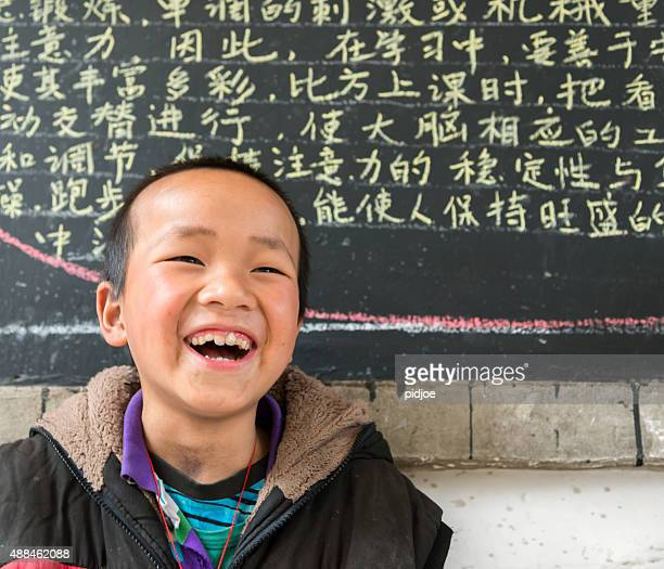 Chinese School boy, looking at camera, cheerful