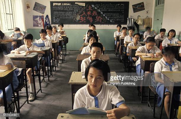 Chinese Schoolkids Sitting in Class