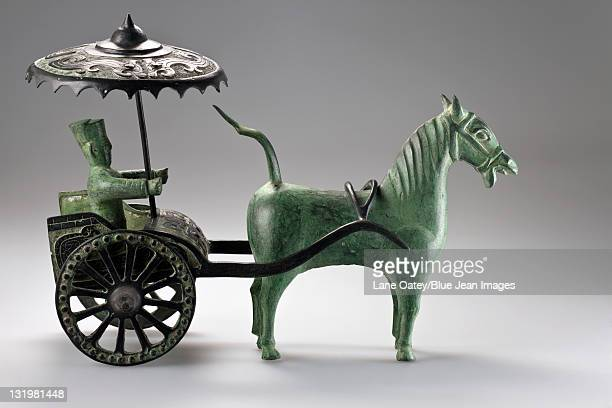 Chinese sculpture of a man riding a chariot