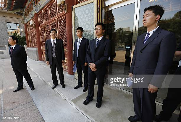 Chinese security agents stand guard outside the Purple Light Pavilion of the Zhongnanhai leadership compound as they await the arrival of US...
