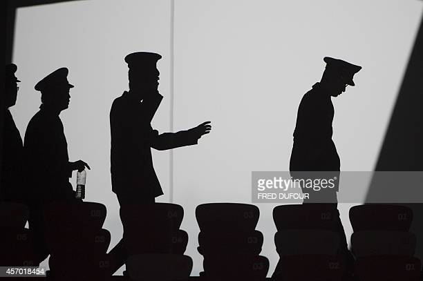 Chinese security guards arrive to watch the trainning of the Brazilian players in the Bird Nest the National stadium in Beijing on October 10 2014 on...