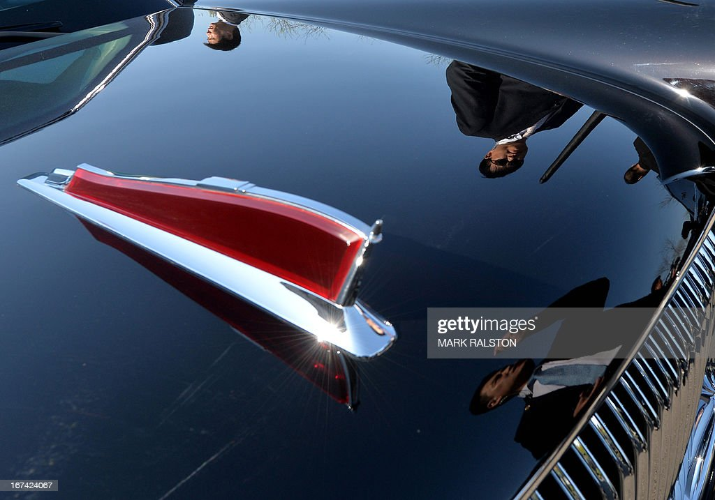 Chinese security is reflected on the Chinese-made Hongqi limousine used by the French President after his arrival in Beijing on April 25, 2013. French President Francois Hollande, accompanied by a high-powered business delegation, started a two-day visit to China, with trade rather than geopolitics at the top of the agenda. For Hollande, beset by economic woes and the aftermath of a damaging corruption scandal that forced his budget minister to resign, it will be a welcome break from his domestic troubles. AFP PHOTO/Mark RALSTON