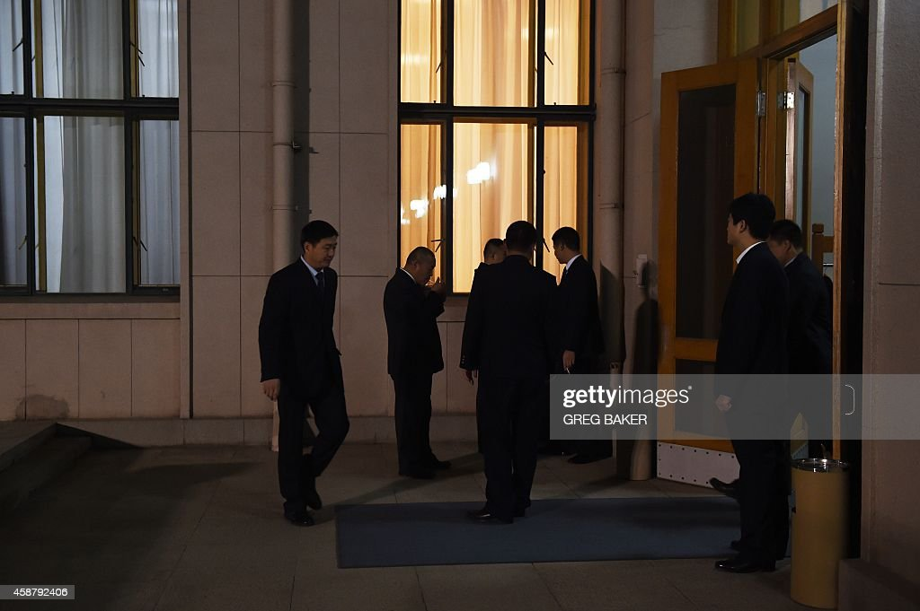Chinese security officials stand outside a waiting room in the Zhongnanhai leadership compound while US President Barack Obama has a private dinner...