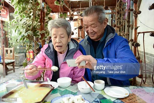 Chinese senior couple raking food picture