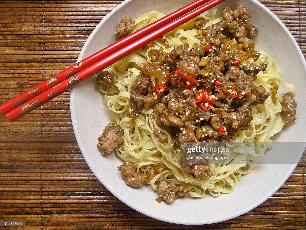 Chinese sesame pork noodles : Stock Photo