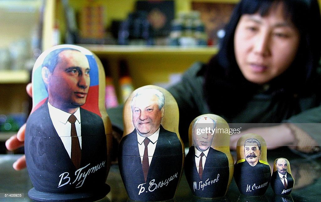 A Chinese shopkeeper displays a doll collection of Russian and former Soviet leaders, 01 December 2002 in Beijing. Russian President Vladimir Putin arrives in China early 02 December for a two-day visit, making him the first world leader to meet with China's next likely president Hu Jintao after he was made general secretary of the ruling Chinese Communist Party last month. Dolls from L to