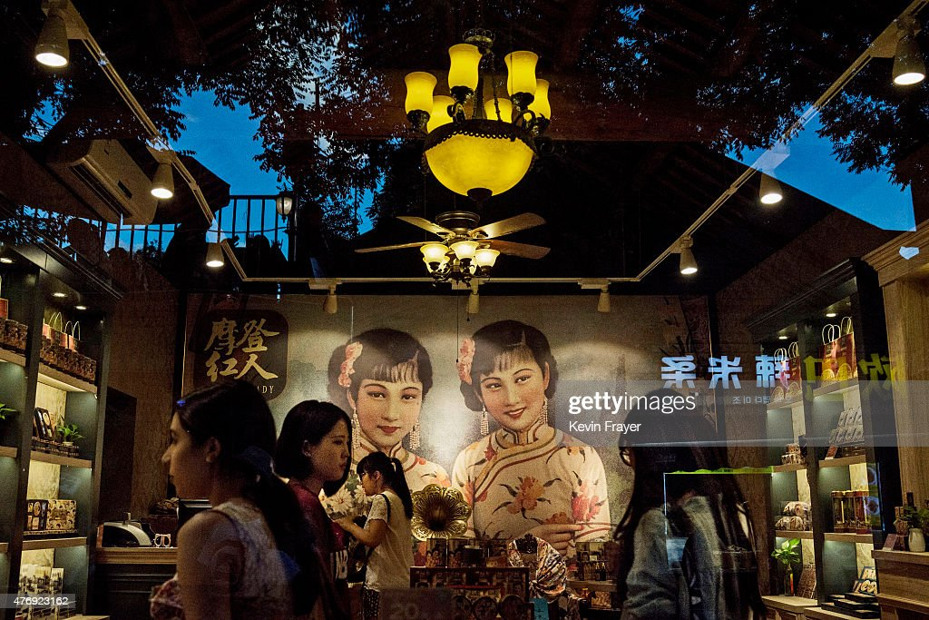 Chinese shoppers and staff stand in a store selling skin creams in a gentrified hutong or traditional neighbourhood on June 12 2015 in Beijing China