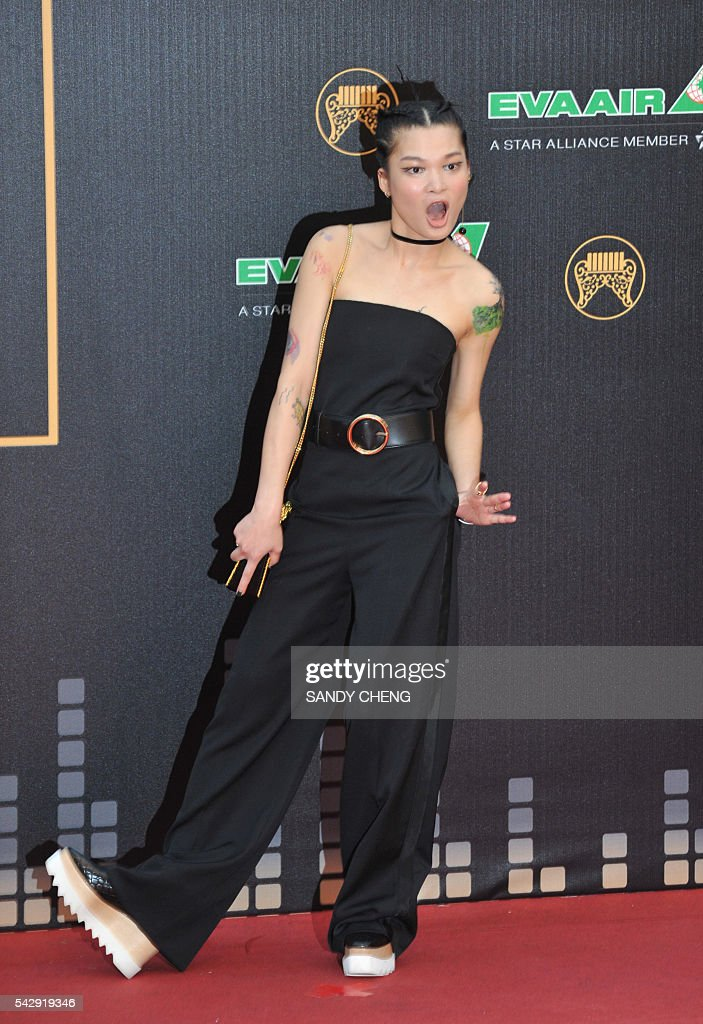 Chinese singer Sue Su arrives to attend the 27th Golden Melody Awards in Taipei on June 25, 2016. Some of Mandarin pop's biggest names have gathered for the annual Golden Melody music awards, with singers, songwriters and composers from Taiwan, China, Hong Kong, Singapore and Malaysia competing in more than 20 categories. / AFP / SANDY