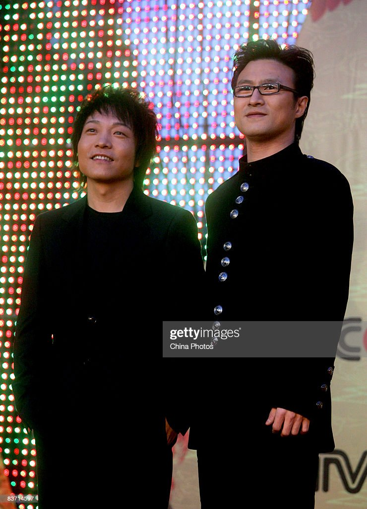 Chinese singers Xu Wei and Wang Feng arrive at the 9th CCTVMTV Music Awards on November 16 2008 in Beijing China