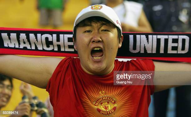 Chinese soccer fans watches the exhibition match between Manchester United and Beijing Hyundai FC at the Workers' Stadiumon July 26 2005 in Beijing...
