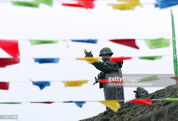 Chinese soldier gestures during a ceremony marking the reopening of the ChinaIndia border at the 15000feet Nathu La Pass in India's northeastern...