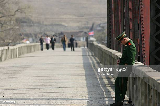 A Chinese soldier guards on a bridge on the ChinaNorth Korea border on April 8 2008 in Linjiang of Jilin Province China Linjiang Linjiang is situated...