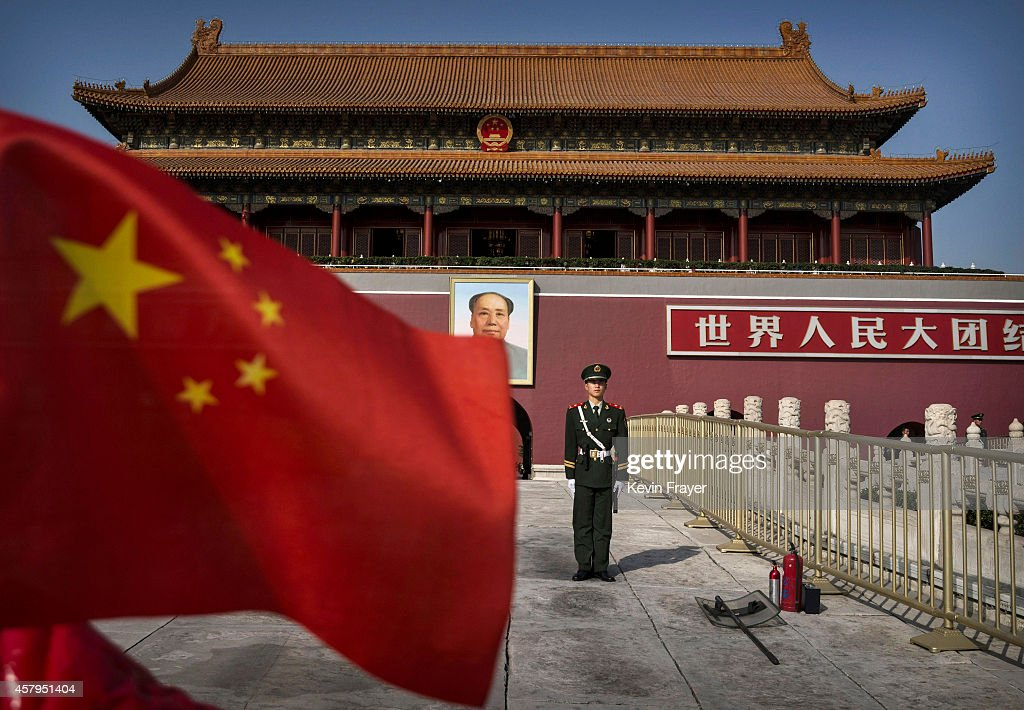Chinese soldier stands guard in front of Tiananmen Gate outside the Forbidden City on October 27 2014 in Beijing China