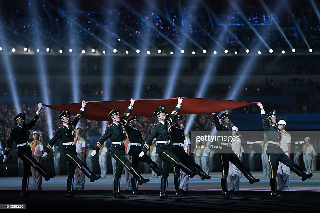 Chinese soldiers carry the national flag during the Closing Ceremony of Nanjing 2014 Summer Youth Olympic Games at the Nanjing Olympic Sports Centre on August 28, 2014 in Nanjing, China.