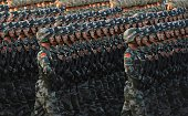 Chinese soldiers conduct a practice at dawn ahead of a military parade later in the morning at Tiananmen Square in Beijing on September 3 to mark the...