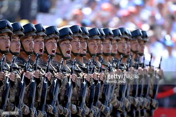 Chinese soldiers march in formation during a military parade in Tiananmen Square in Beijing on September 3 to mark the 70th anniversary of victory...