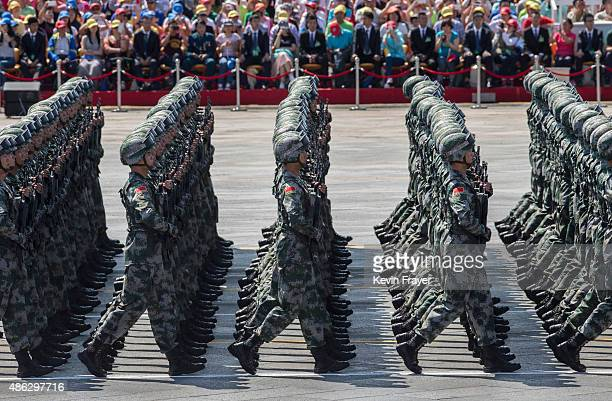 Chinese soldiers march in formation passed Tiananmen Square and the Forbidden City during a military parade on September 3 2015 in Beijing China...