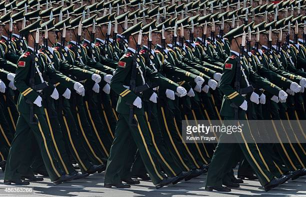 Chinese soldiers march in formation past Tiananmen Square and the Forbidden City during a military parade on September 3 2015 in Beijing China China...
