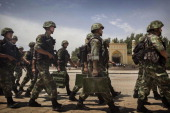Chinese soldiers march in front of the Id Kah Mosque China's largest on July 31 2014 in Kashgar China China has increased security in many parts of...