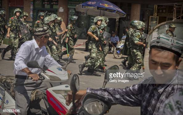 Chinese soldiers march past near the Id Kah Mosque China's largest on July 31 2014 in Kashgar China China has increased security in many parts of the...
