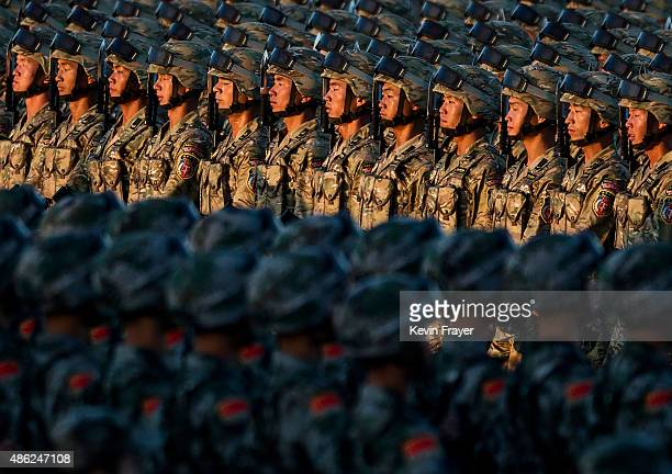 Chinese soldiers march past Tiananmen Square before a military parade on September 3 2015 in Beijing China China is marking the 70th anniversary of...