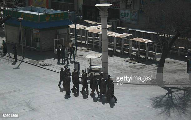 Chinese soldiers patrol the streets in the Tibetan capital Lhasa on 19 March 2008 after violent protests broke out following days of demonstrations...