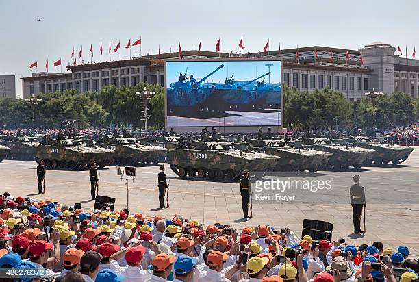 Chinese soldiers ride in tanks as they pass in front of Tiananmen Square and the Forbidden City during a military parade on September 3 2015 in...