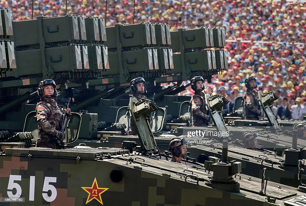 Chinese soldiers ride on armoured missile carriers as they pass in front of Tiananmen Square and the Forbidden City during a military parade on September 3, 2015 in Beijing, China. China is marking the 70th anniversary of the end of World War II and its role in defeating Japan with a new national holiday and a military parade in Beijing.