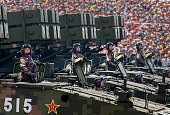 Chinese soldiers ride on armoured missile carriers as they pass in front of Tiananmen Square and the Forbidden City during a military parade on...