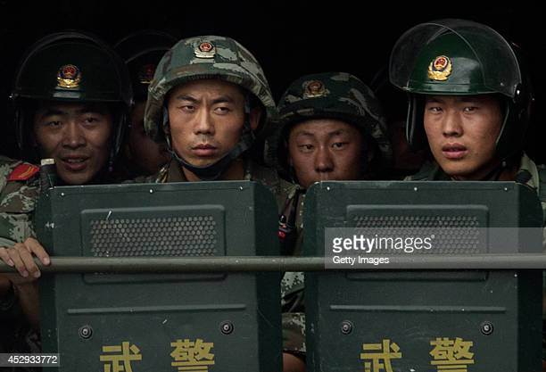 Chinese soldiers ride on the back of a truck as they patrol outside the Id Kah Mosque China's largest on July 31 2014 in Kashgar China China has...