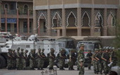 Chinese soldiers stand in formation in front of the Id Kah Mosque China's largest on July 31 2014 in Kashgar China China has increased security in...