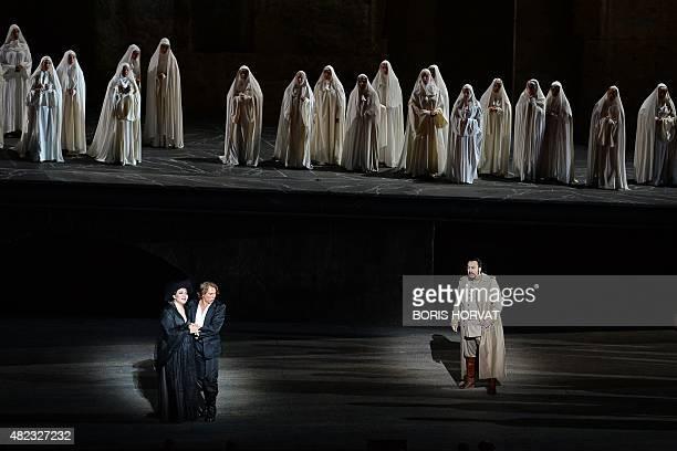Chinese soprano Hui He as Leonora French tenor Roberto Alagna as Manrico and Romanian baritone George Petean as Il Conte di Luna perform during the...