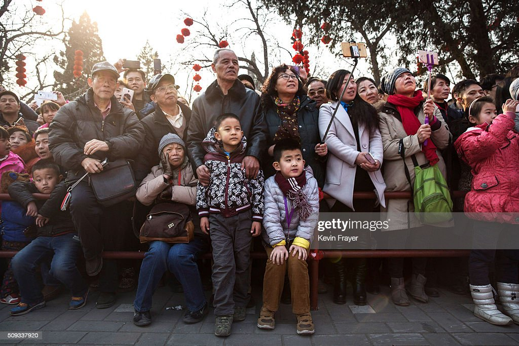 Chinese spectators watch performers at a local fair during Spring Festival celebrations on February 10, 2016 in Beijing, China. The Chinese Lunar New Year also known as the Spring Festival, which is based on the Lunisolar Chinese calendar, is celebrated from the first day of the first month of the lunar year and ends with Lantern Festival on the fifteenth day. This new year marks the Year of the Monkey.