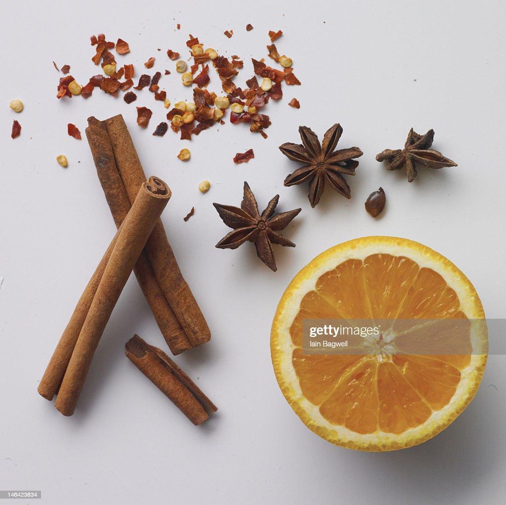 Chinese star anise, cinnamon, red pepper, orange : Stock Photo