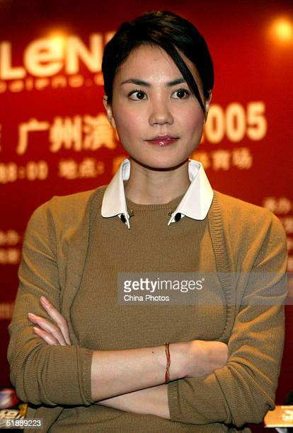 Chinese Star Faye Wong takes a question at a news conference on December 22 2004 in Guangzhou China Wong will hold her concert in Guangzhou on...