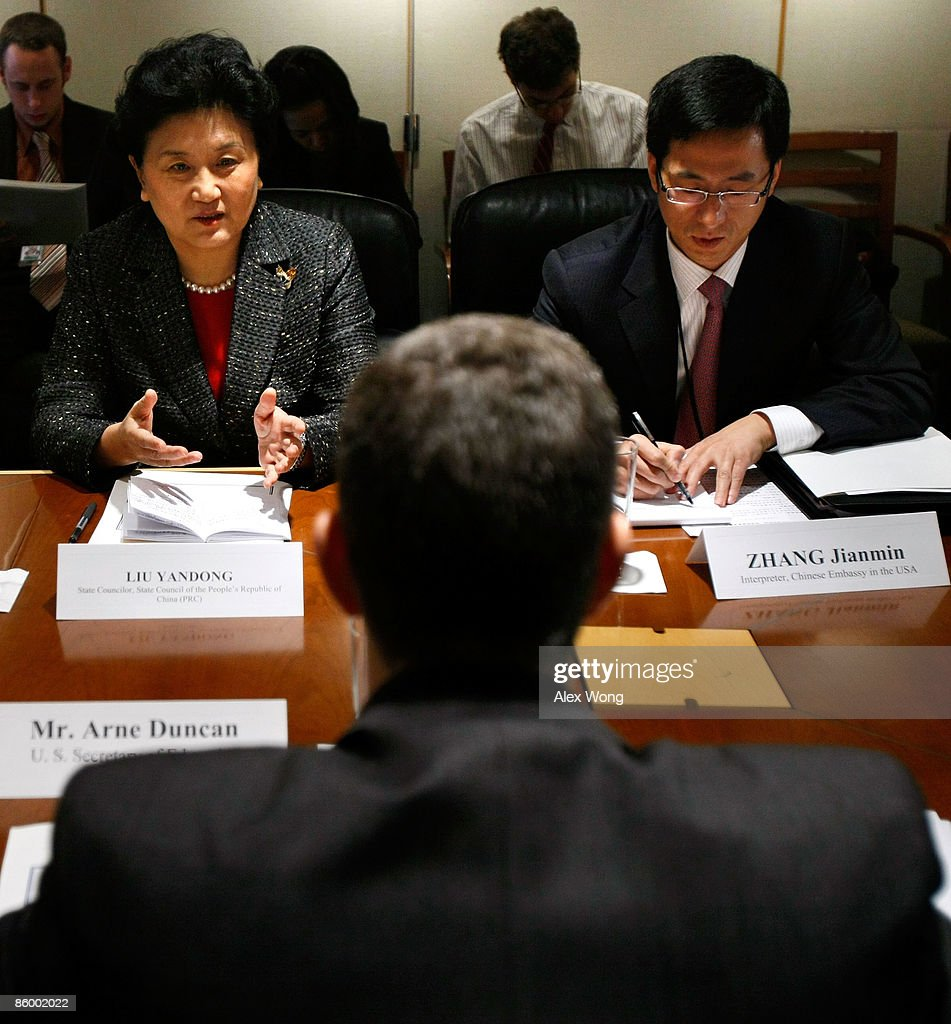 Chinese State Councilor Liu Yandong (L) speaks as she meets with U.S. Secretary of Education Arne Duncan (C) at the U.S. Department of Education April 16, 2009 in Washington, DC. Education officials of both countries met in Washington to discuss ways to improve education in the United States and China and signed the 2009 U.S.-China Work Plan on Education Activities and the Joint Statement of Exchange and Cooperation in Higher Education.