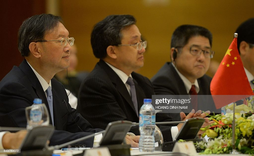 Chinese State Councilor Yang Jiechi (L) listens as he attends the 9th joint-meeting on bilateral cooperation between Vietnam and China with Vietnamese Deputy Prime Minister and Minister of Foreign Affairs Pham Binh Minh (not pictured) in Hanoi on June 27, 2016. Yang is in Vietnam to attend the 9th joint-meeting on bilateral cooperation between the two countries. / AFP / HOANG