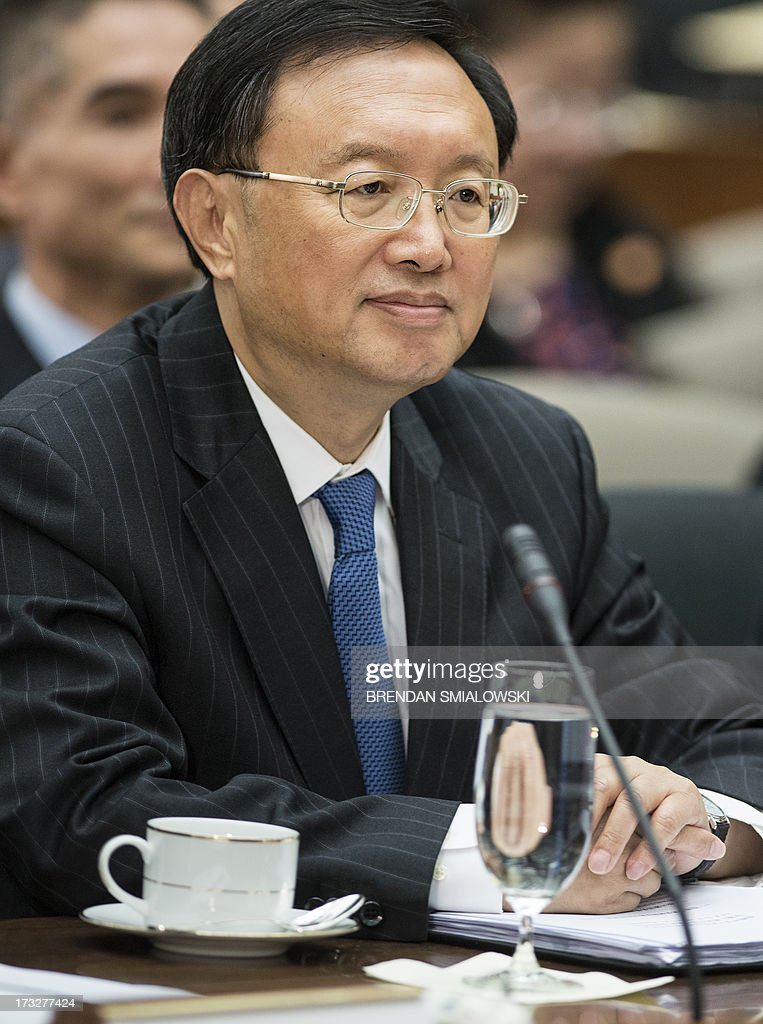 Chinese State Councilor Yang Jiechi listens during a Strategic Track Plenary Session at the US Department of State July 11, 2013 in Washington, DC. Officials from the United States and China are meeting to discuss the two world powers' relationships. AFP PHOTO/Brendan SMIALOWSKI