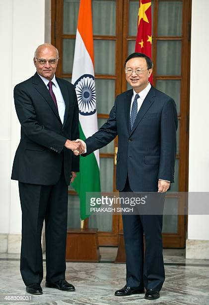 Chinese State Councilor Yang Jiechi shakes hands with Indian National Security Adviser Shiv Shankar Menon prior to a meeting in New Delhi on February...