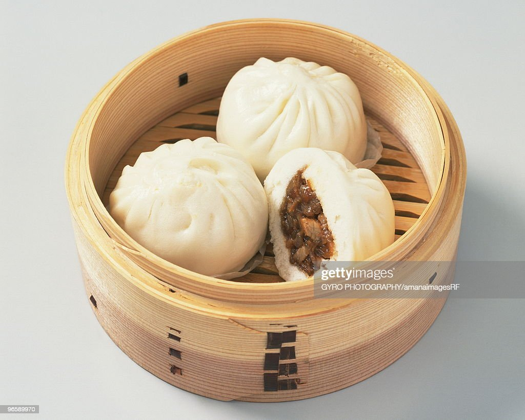 Chinese steamed buns in a bamboo steamer : Stock Photo
