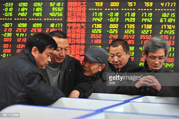 Chinese stock investors gather at a securities firm in Fuyang in China's Anhui province on January 7 2015 China's benchmark Shanghai Composite Index...