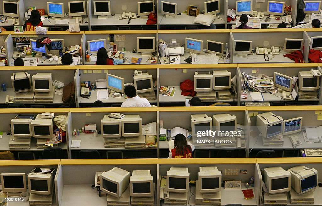Chinese stock traders work on the nearly empty trading floor at the Shanghai Stock Exchange in Shanghai 19 May 2006 China ended a yearlong ban on...