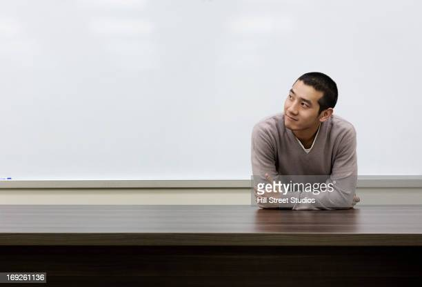 Chinese student standing at whiteboard in classroom