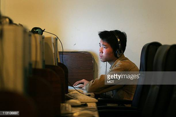 A Chinese student surfs the web at an internet cafe in Shanghai China April 22 2005 China pours huge resources into filtering online content stifling...