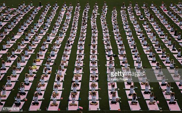 Chinese students from Geely University take part in a yoga workshop marking the International Day of Yoga at an event sponsored by the Government of...