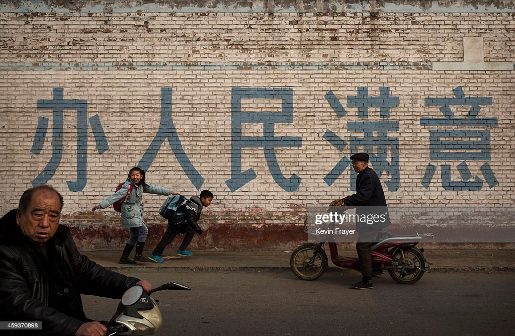 Chinese students joke with each other as they walk to school on November 21 2014 in Hebei just outside Beijing China The Hebei Province lies north of...