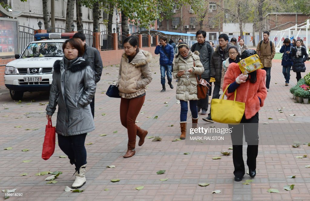 Chinese students leave the Sanlitun No 1 Middle School as they take a lunch break during the annual civil service examinations in Beijing on November 25, 2012. Chinese state media reports that applicants for this years exam have exceeded 1.5 million with only 20,000 vacancies available and with the most desirable jobs at the National Bureau of Statistics with over 9,000 applicants for every vacancy. AFP PHOTO/Mark RALSTON
