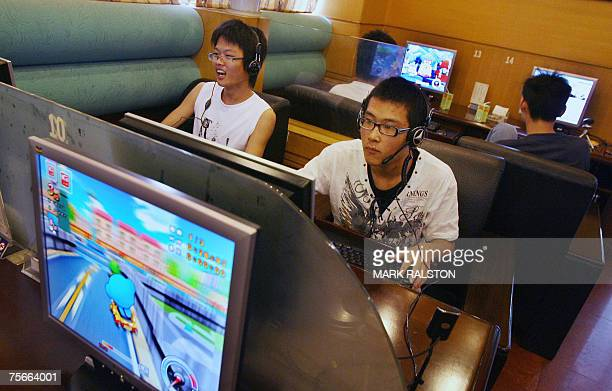 Chinese students play online computer games at an internet cafe during their summer holidays in Hangzhou 26 July 2007 China looks set to overtake the...