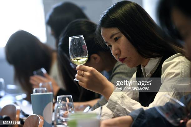 Chinese students taste and study wine during a class on March 16 2017 at the School of Wine of the Dijon Business School Chinese students represent...